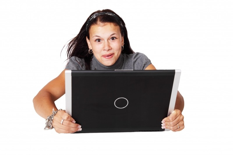 portrait-of-young-woman-with-laptop