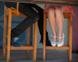 couple-sitting-in-wooden-chairs